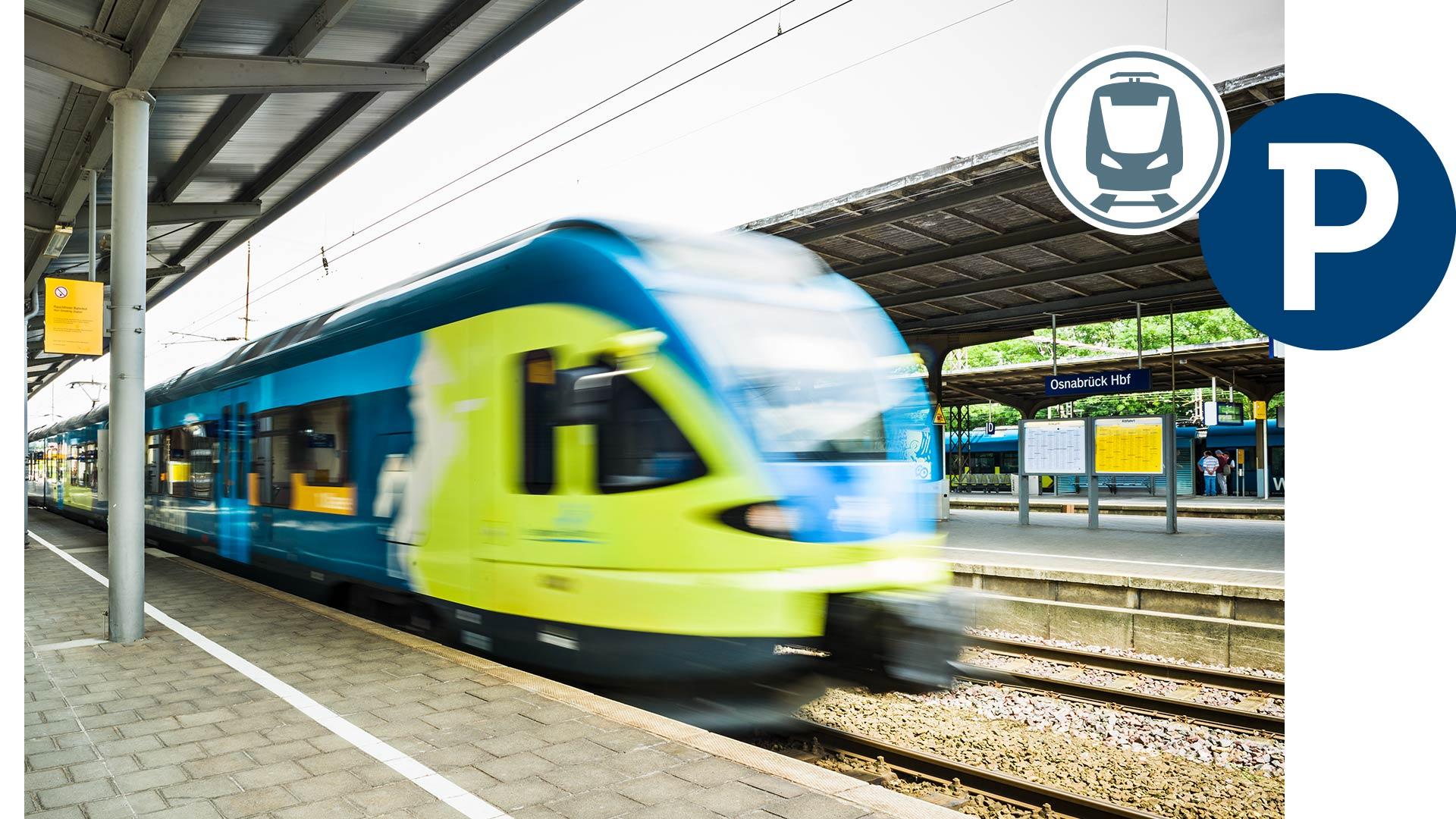 Einfahrender Zug an einem Gleis am Hauptbahnhof Osnabrück
